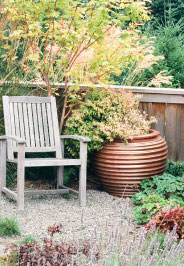 chair and planter in garden